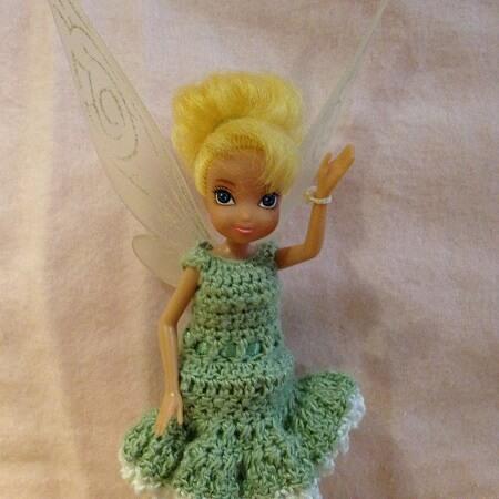 Tinkerbell waving.