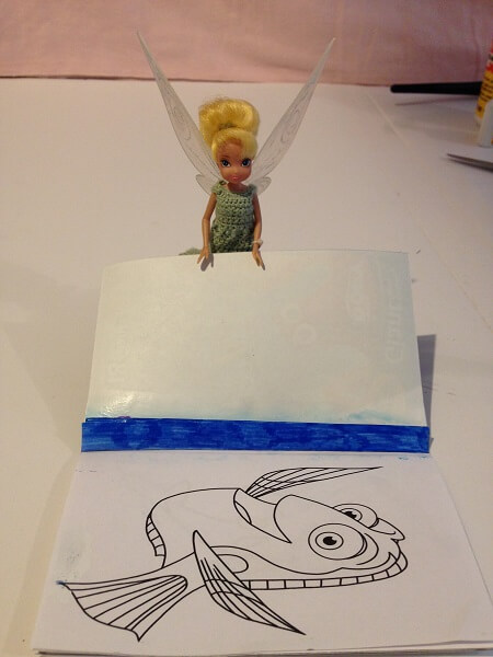 Tinkerbell with doll-sized coloring book