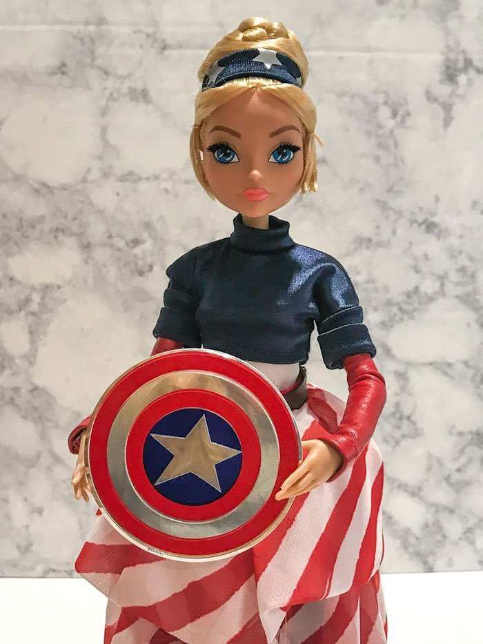 Image of: Captain America Fan Girl Doll holding a shield.