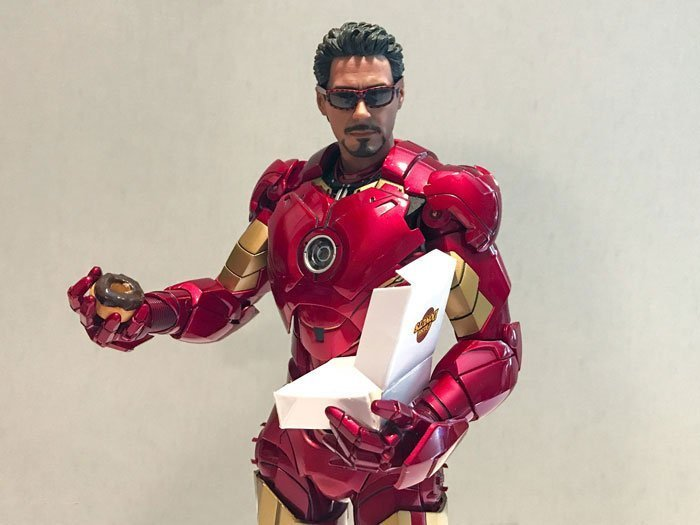 Hot Toys Iron Man Mark IV wearing glasses and holding donut.