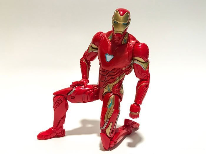 Iron Man action figure in kneeling position.