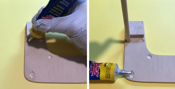 Use a strong glue to attach the legs to the bottom of the desk.