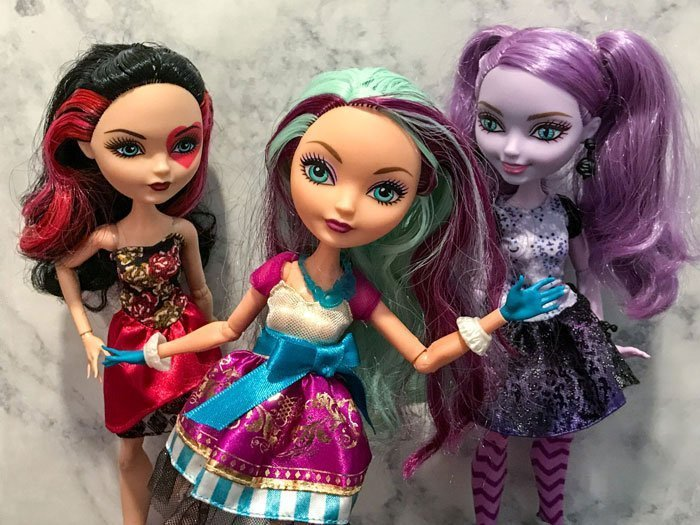Ever After High dolls: Lizzie Hearts, Madeline Hatter, and Kitty Cheshire.