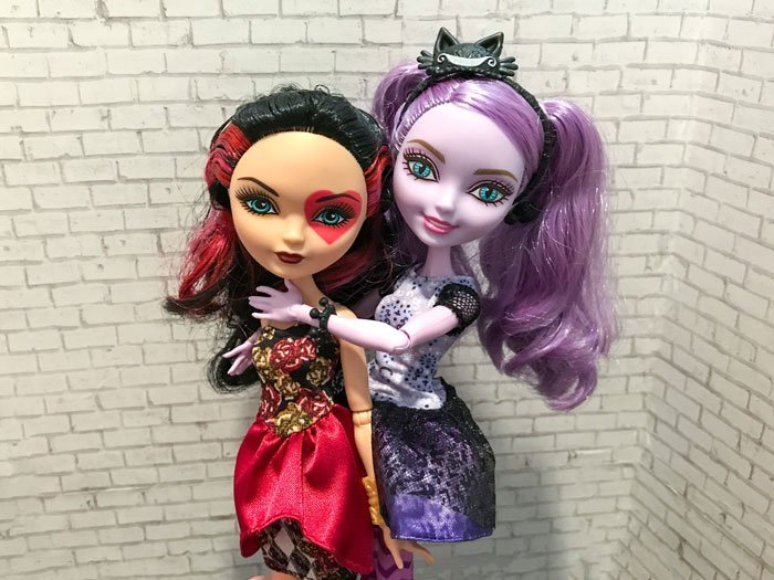 Image of Lizzie Hearts and Kitty Cheshire dolls.