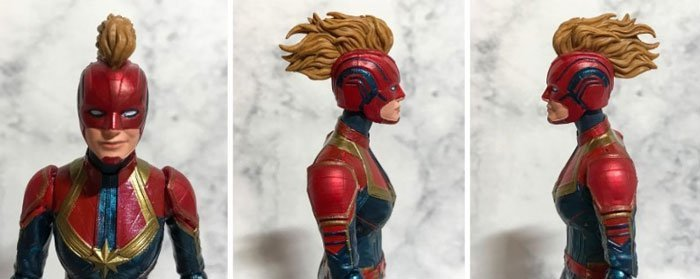 Captain Marvel with her masked head.