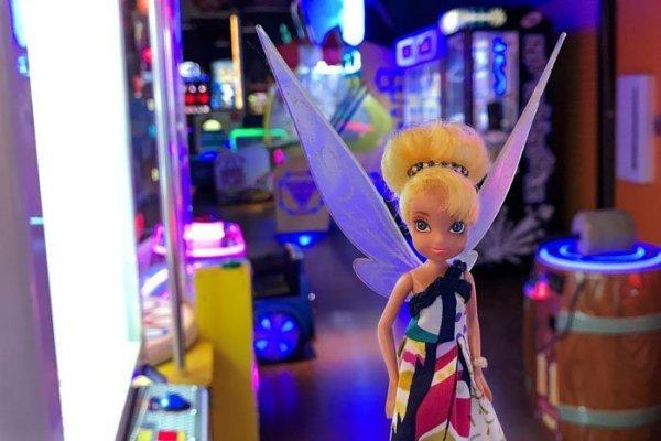 Tinkerbell visits an arcade.