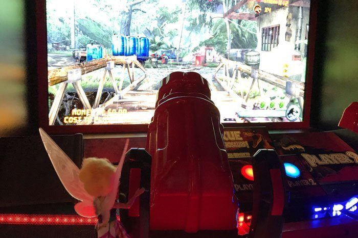 Tink playing Jurassic Park game.