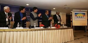 2-releasing-the-logo-of-uday-scheme-at-mou-signing-ceremony-on-uday