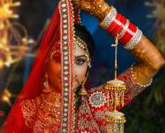 woman in red and gold sari dress