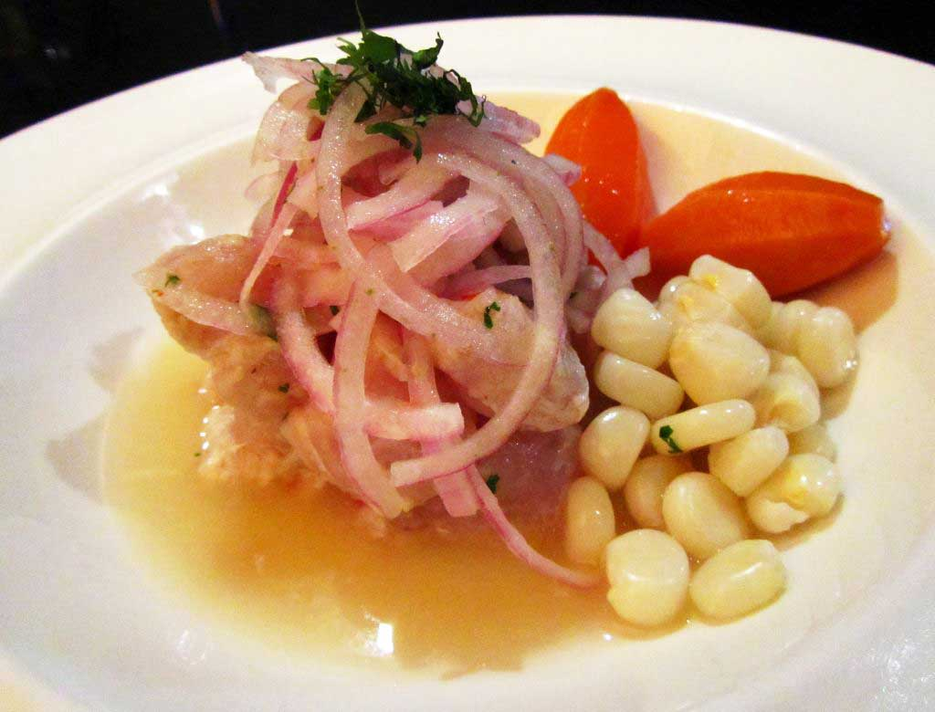 Ceviche Wallqa con camotes glaseados. Wallqa Ceviche with glazed sweet potatoes. Image by placeOK