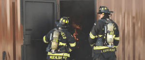 firefighters observing a training fire
