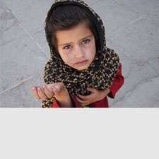 10 yo Afghan girl looking up at camera begging