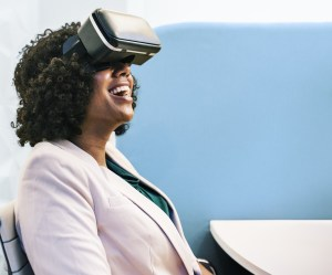 Photo of woman wearing virtual reality headgear