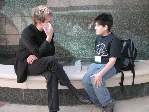 Aarron as a tween sitting with Lawrence Lessing