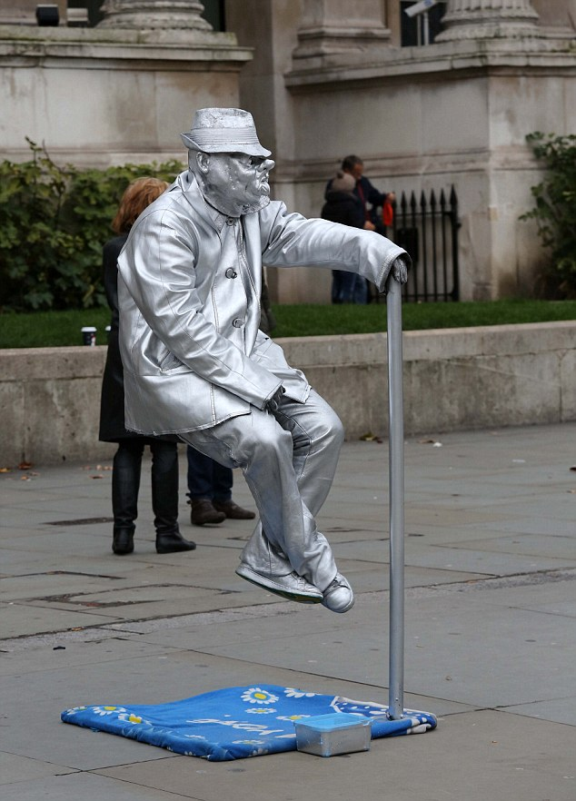 Picture by Mark Richards-Jane Fryer goes in search of living statues in London.