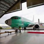 The Green BBJ Boeing Business Jet is towed into the hangar after non stop Pacific flight