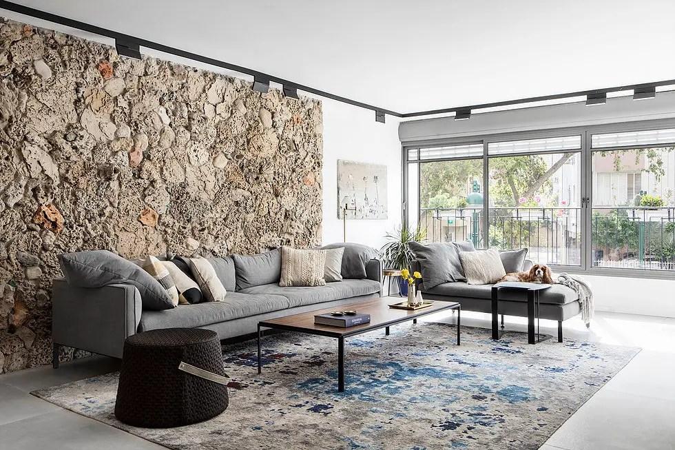 Un salon contemporain au mur en pierres - PLANETE DECO a ...
