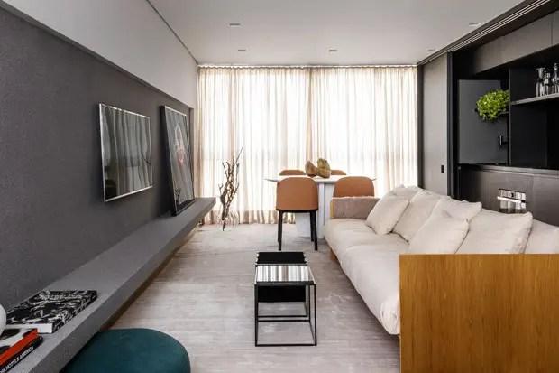 Un appartement au design intégrant une cuisine invisible