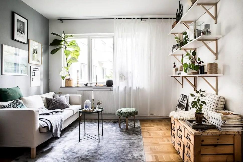 Une cuisine verte dans un appartement vintage