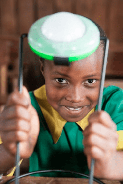 Child with a Solar Aid lamp (Source: the Honnold Foundation)