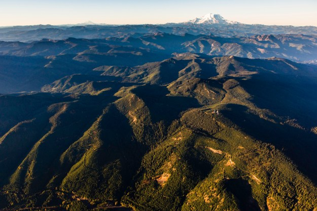 Aerial view of The Nature Conservancy's Great Western Checkerboards Project south of Cabin Creek, Washington with Mt. Rainier in background. The project preserves recreational access and helps conserve the ecological integrity of 165,073 acres of forests, rivers and wildlife habitat in the Cascade Mountain Range of Washington and in the Blackfoot River Valley in Montana. (Photo Credit: © Benjamin Drummond)
