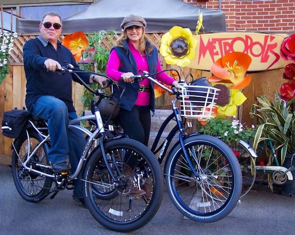 William Shatner and his wife on their Pedegos. Don says Shatner's wife made him trade in his motorcycles for a Pedego after one crash too many. (Image: Pedego)