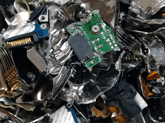 Pieces of a destroyed hard drive. (Image Credit: IT Liquidators)