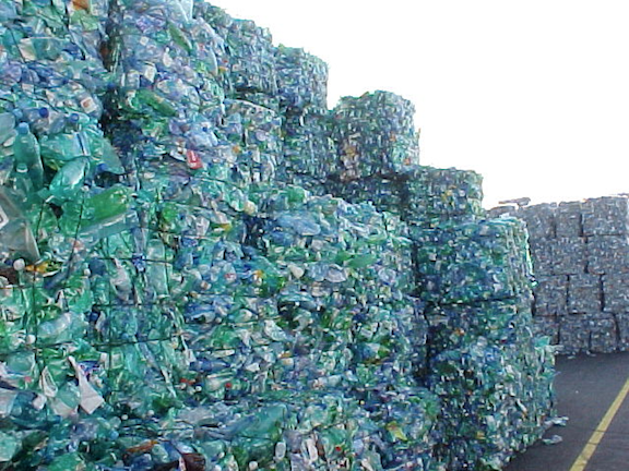 Bales of plastic bottles waiting to be recycled. (Image: WikiMedia Commons)