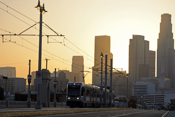 Eastside Gold Line and Los Angeles skyline. (Image Credit: JulieAndSteve / Flickr)