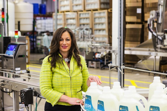 Kelly with EFP's ECOS brand laundry detergent. (Photo: EFP)
