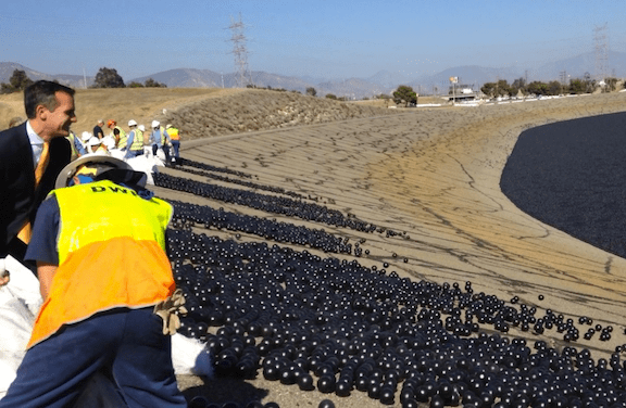 Mayor Garcetti and others release the final 20,000 'shade balls' into the LA Reservoir. (Photo Credit: LA Mayor's Office)