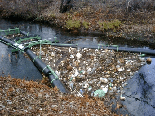 Downriver plastic collection net system in Australia.
