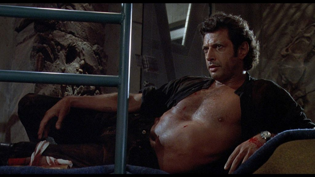 Shirtless Jeff Goldblum lounges in Jurassic Park.