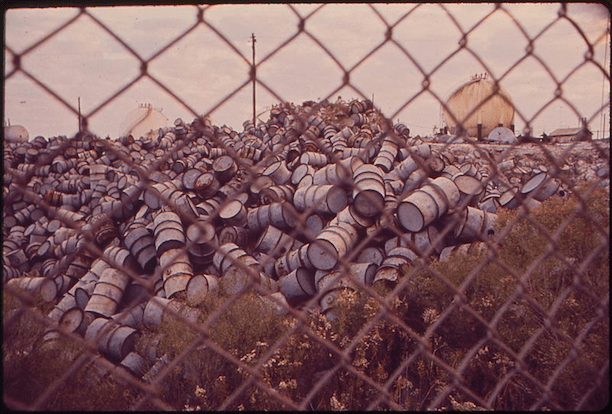 Damaged oil drums near Exxon refinery in Baton Rouge, Louisiana, 1972. (Photo Credit: John Messina / Still Picture Records Section, Special Media Archives Services Division)