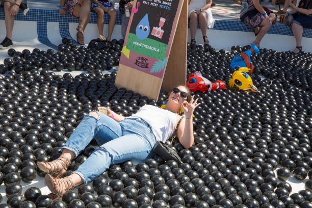 A poolgoer lounging atop some LA shade balls. (Photo by Alison Buck/Getty Images for DIGDEEP)