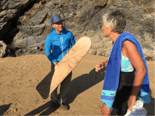 Ramon Navarro and I marvel at this pre-plastic surfboard. (Photo via 5 Gyres)