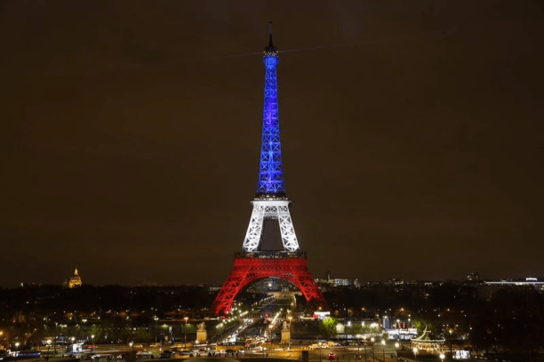 The Eiffel Tower lit up in French colors after the November 2015 Paris attacks. (Photo Credit: Divulgação Prefeitura de Paris)