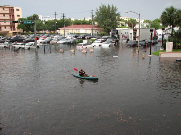 A kayak in the streets of Miami Beach, Florida, in 2009 during a king tide flood that may have been exacerbated by the stormy weather. (Photo Credit: maxstrz / Flickr)