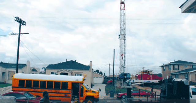 Warren E & P drill site, smack in the middle of homes in Wilmington, South Los Angeles. (Photo Credit: Liberty Hill Foundation)