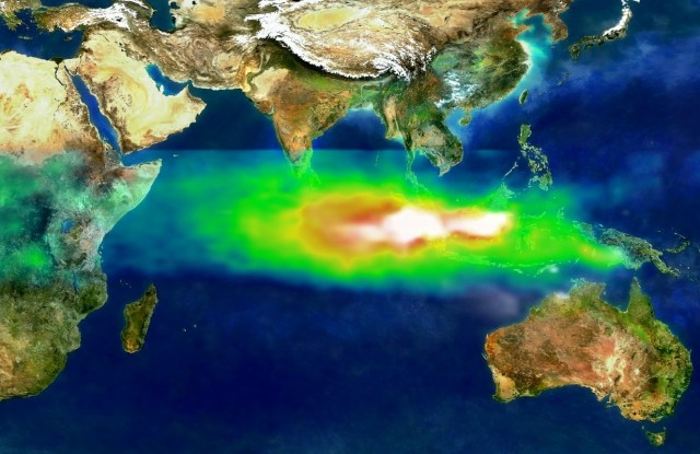 This image shows the pollution over Indonesia and the Indian Ocean on October 22, 1997. White represents the aerosols (smoke) that remained in the vicinity of the fires. Green, yellow, and red pixels represent increasing amounts of tropospheric ozone (smog) being carried to the west by high-altitude winds. (Photo via NASA)