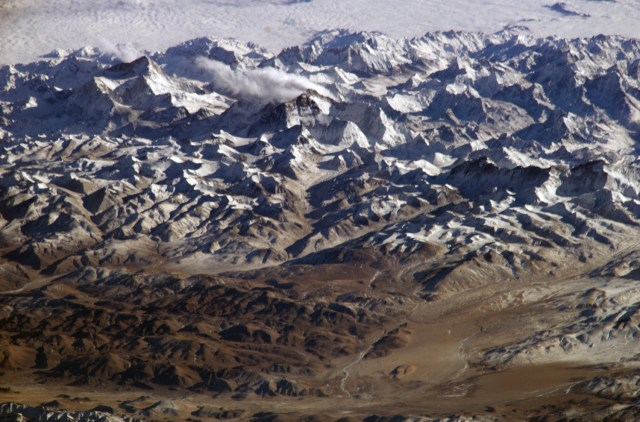 The Himalayas as seen from space looking south from over the Tibetan Plateau. (Photo Credit: NASA)