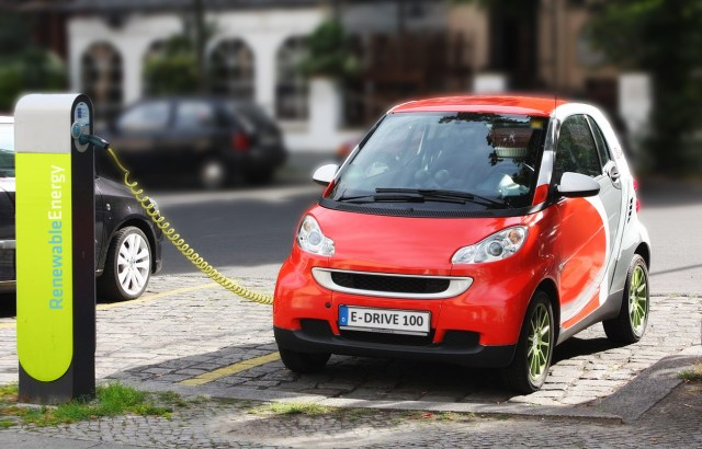 Electric car recharging in Berlin, Germany. (Photo Credit: Michael Movchin)