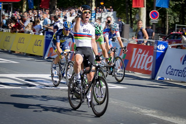 Cavendish winning the 2012 Tour de France on the Champs-Élysées, for a record fourth successive year. Photo © William Morice / MaxPPP