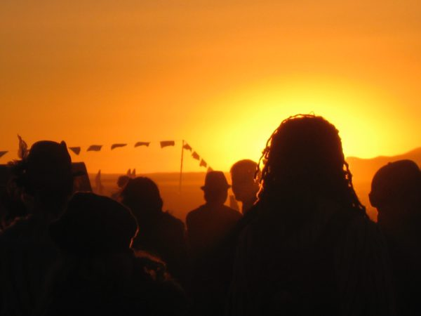 Burning Man attendees at sunrise, 2008. (Photo Credit: Ariane Sims)