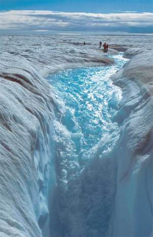Water flows through a moulin on the Greenland Ice Sheet. (Photo Credit: NASA)