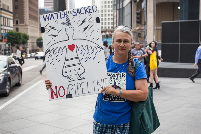 Planet experts spoke to a handful of demonstrators to find out why protesters are standing with Standing Rock. (Photo: Brian Klonoski / Planet Experts)