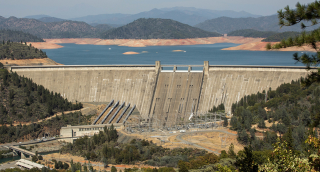 California's Shasta Dam with a receding Lake Shasta in the background during drought conditions in September 2014. (Photo: Dan Brekke / Flickr)