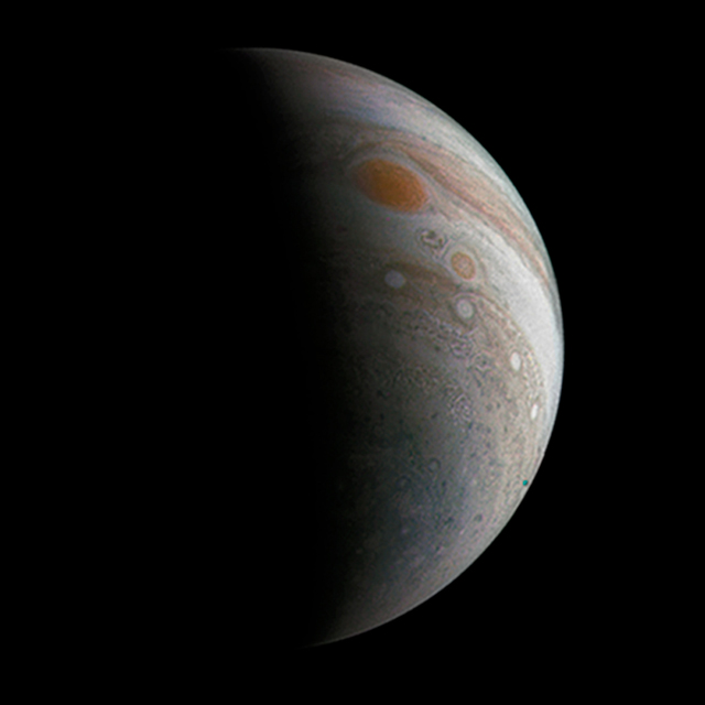 Juno cam captures a crescent Jupiter, hanging in the darkness like a ghost. (Photo: NASA / JPL)