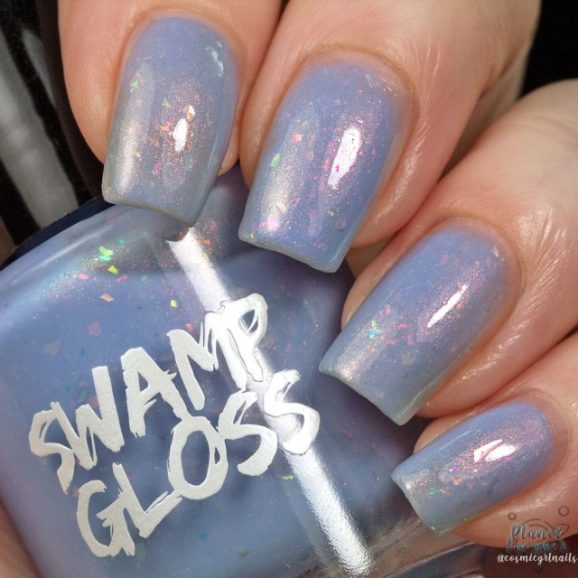 Pictured here is a swatch of 'Sup by Swamp Gloss is a periwinkle tinted nail polish by Swamp Gloss Polish. Artificial light.