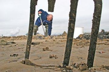 a digger seen through a broken fork